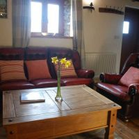 Comfortable leather sofa in The Hayloft