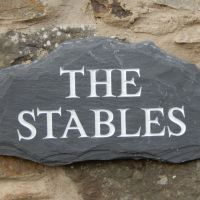 The Stables slate sign