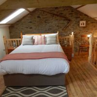 Spacious bedroom with king-sized bed in The Hayloft