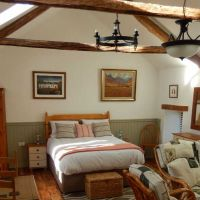 Large bedroom area with lots of storage space in The Stables